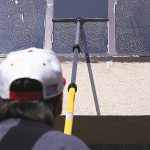 Alumiglass® Telescopic Extension Poles cleaning windows.