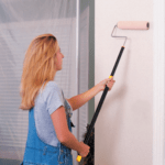 Painting a wall with the TeleRoller paint roller extension pole.