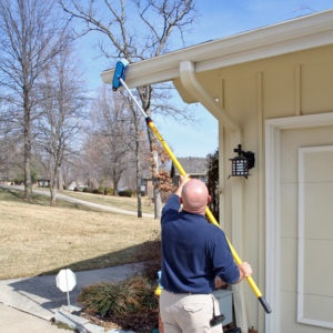 Cleaning gutters with the soft brush and Alumiglass extension pole